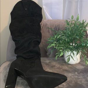 Knee high pointed toe boots